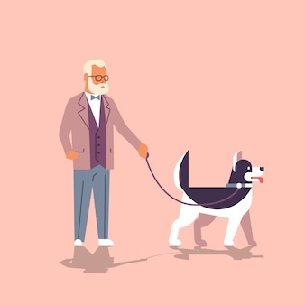 ハスキーと歩く年配の男性