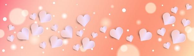 ピンクのハートバナーとバレンタインデーボケ背景