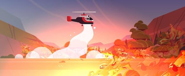 Вертолет тушит опасный лесной пожар в австралии бои кустарник огонь сухие леса горящие деревья пожаротушение концепция стихийных бедствий интенсивное оранжевое пламя горизонтальное