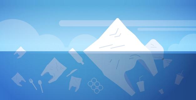 海洋でのプラスチックのごみ汚染の環境問題は、平らな水平水に浮かんでいる地球の概念のバッグや他の汚染廃棄物を救う