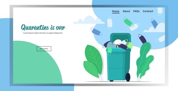 Использованные защитные маски в мусорном ведре глобальный пандемический коронавирус карантин окончен