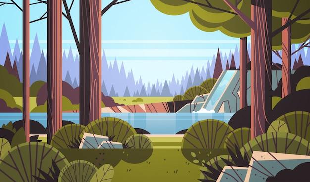 岩が多い崖の緑の夏の森の自然風景の上の美しい滝