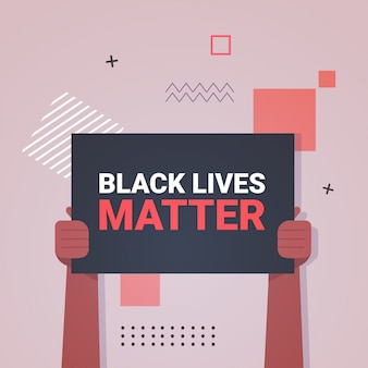 黒い肌を持っている手は、暗い肌の色の人種差別に対するバナー意識向上キャンペーンを重要視しています