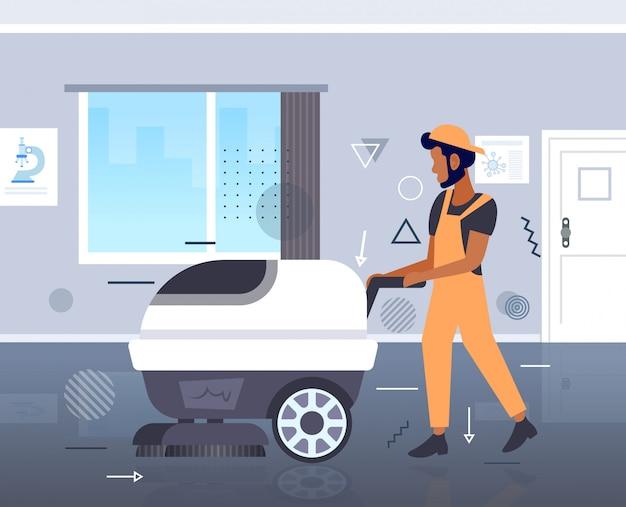 制服の床のケアクリーニングサービスコンセプトモダンなオフィスインテリア水平全長スケッチで洗濯機男性用務員を使用している人