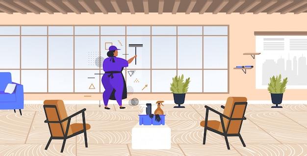 制服洗浄ウィンドウクリーニングサービスコンセプトモダンなオフィスインテリア全長スケッチ水平でワイパースキージ女性用務員を使用して女性クリーナー