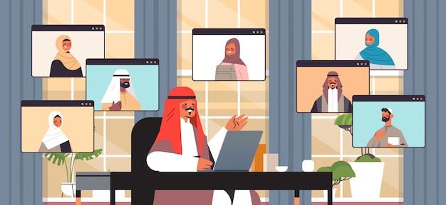 ビデオ会議中にアラビア語の同僚とチャットするアラビア語の実業家オンライン会議会議通信概念オフィスインテリア水平肖像イラストを持つビジネス人々