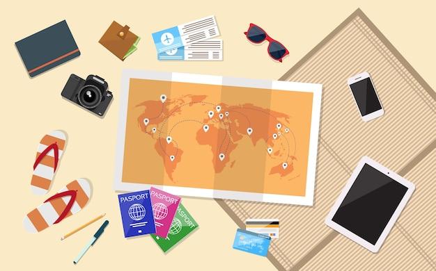 チケットの搭乗券旅行の手の手の世界の地図