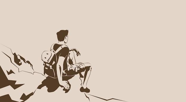 Путешественник сидит на скале
