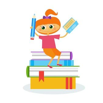 小さな女の子は本の束に座って読む