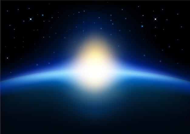 青く輝く背景に地球上で上昇する太陽