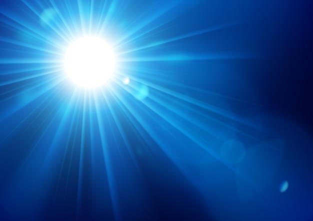 レンズフレアの背景で輝く青い光