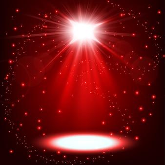 赤いスポットライトが散水して輝いている