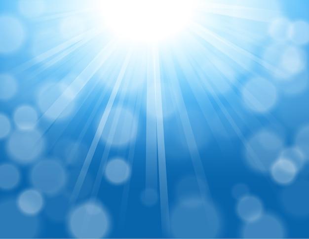 ボケの背景で輝く青い光