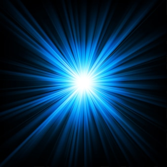 暗闇の背景から輝く青い光