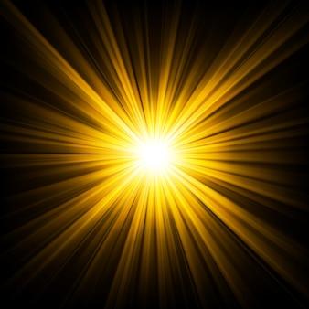 暗闇の背景から輝く金色の光