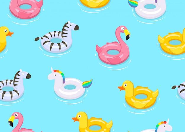 カラフルな動物のシームレスパターンが浮かぶかわいい子供のおもちゃ