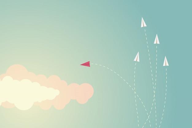 方向とものを変えるミニマリストスタイルの赤い飛行機