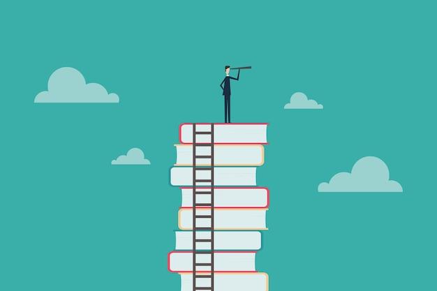 Концепция образования бизнесмен, стоя на книги, глядя в будущее