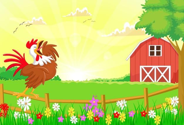 かわいい鶏が農場の柵で鳴っている
