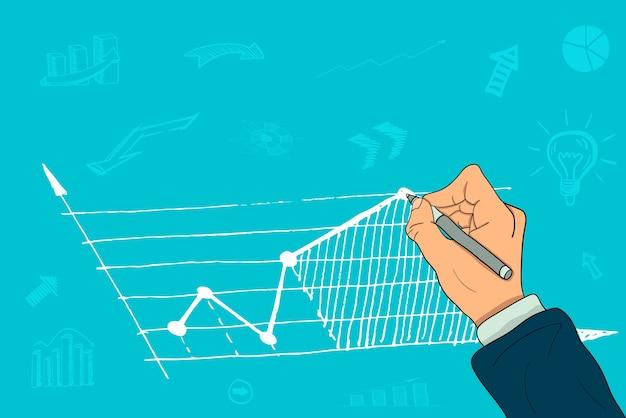 ビジネスマンの手が成長チャートを描く