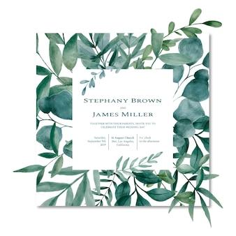 Квадратная свадебная открытка, украшенная акварельными листьями.