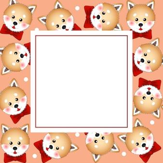 オレンジバナーカードに赤いリボンの芝犬犬
