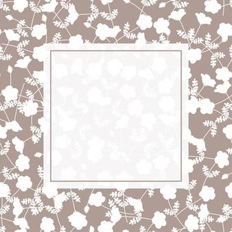 Белая цветочная рамка на светло-коричневом фоне