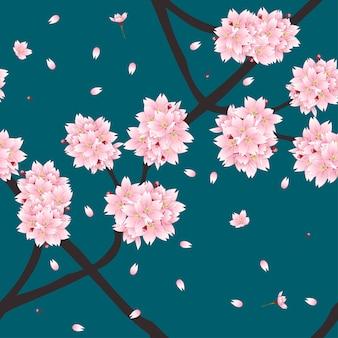 Цветок вишневого цветка на фоне зеленого теама индиго.