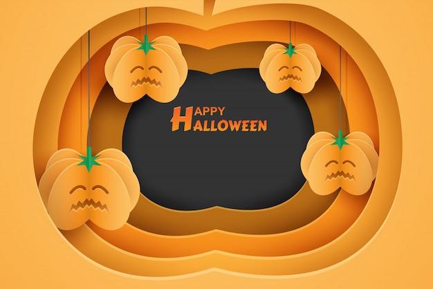 オレンジ色の背景紙アートスタイルに掛かっているカボチャと幸せなハロウィーンデザイン