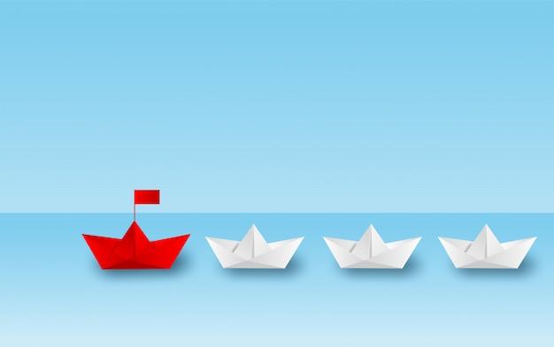 Бумажный кораблик красный лидер идти к цели успеха.
