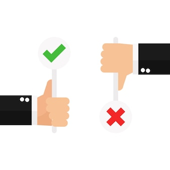 真と偽のサインを持つビジネスハンドの親指