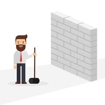 ハンマーで壁を破るビジネスマン