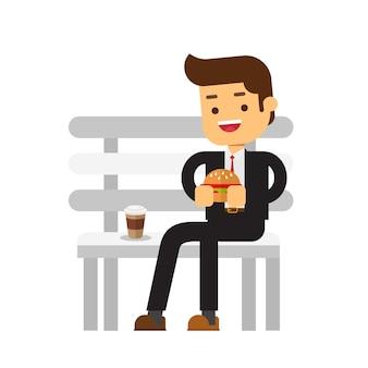 ハンバーガー、コーヒーを食べるビジネスマン
