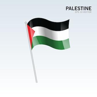 パレスチナは、灰色の背景に旗を振って