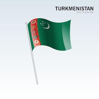 トルクメニスタン、灰色の背景に旗を振る