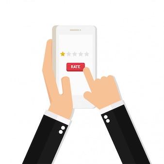 片手にスマートフォンと指押しの「レート」ボタンがあります