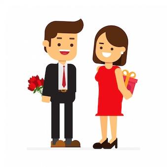 幸せなバレンタインデー。彼氏にギフト用の箱を与える女性