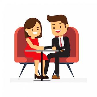 幸せなバレンタインデー、レストランのテーブルに座っていると手を繋いでいる恋人のカップル。ロマンチックなデート
