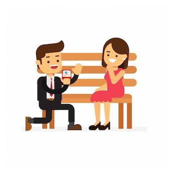 ベンチに座っている女性に提案している男