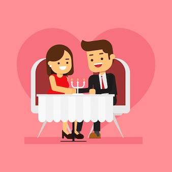 レストランで夕食を食べている若いカップル