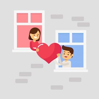 バレンタインデーのフェスティバルのウィンドウで素敵に幸せなカップル