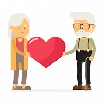 Счастливые бабушка и дедушка с большим знаком сердца