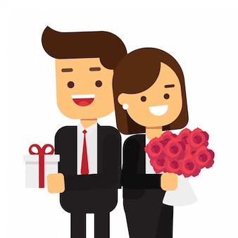 ギフト用の箱と魅力的な若いカップル