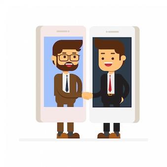 携帯電話を介して相互作用するビジネスマン