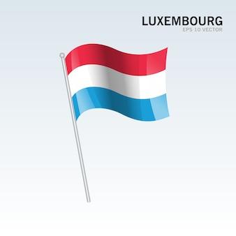Люксембург развевающийся флаг, изолированных на сером фоне