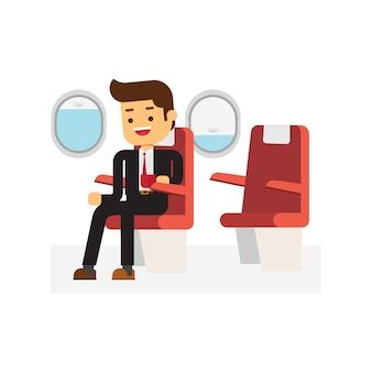 Бизнесмен, сидя в кресле и расслабиться в бизнес-классе