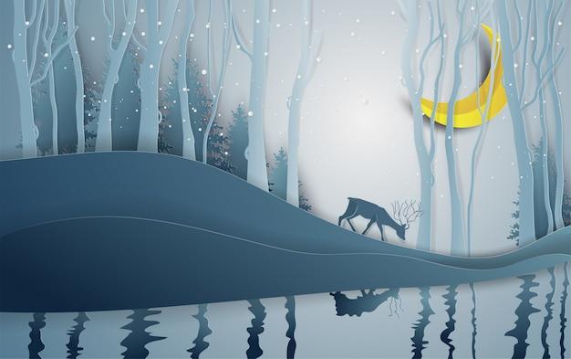 Бумажный стиль искусства зимнего сезона и оленей в лесу пейзаж со снежным фоном.