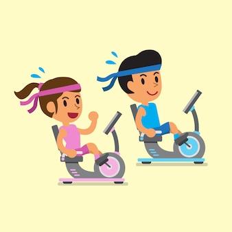 リカンベントエアロバイクに乗る男女を漫画します。