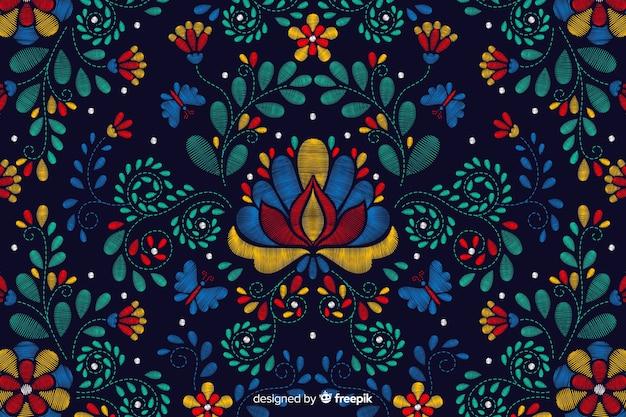 刺繍の伝統的なメキシコの花の背景