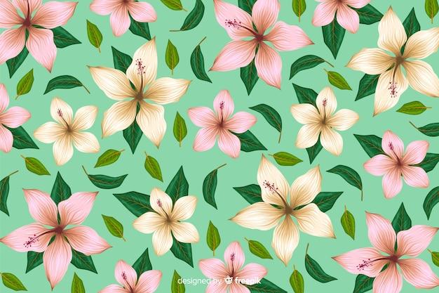 平らな熱帯の花模様の背景